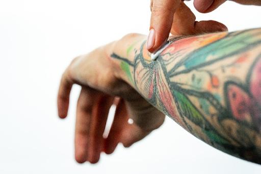 putting shea butter on my tattoo